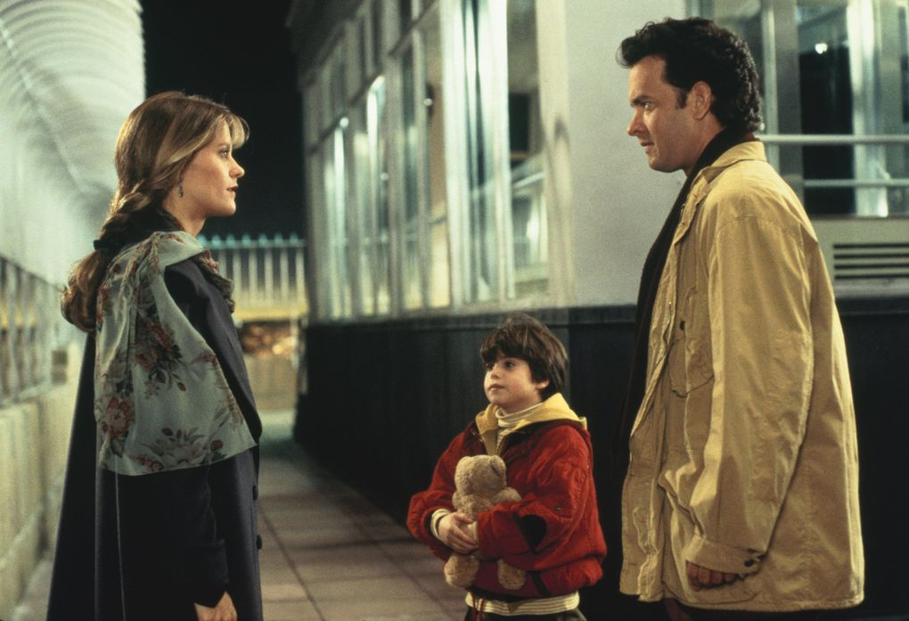 """Meg Ryan as Annie Reed, left, Ross Malinger as Jonah Baldwin, center, and Tom Hanks as Sam Baldwin in a scene from """"Sleepless in Seattle,"""" written and directed by Nora Ephron. (1993 TriStar Pictures, Inc. / Associated Press)"""