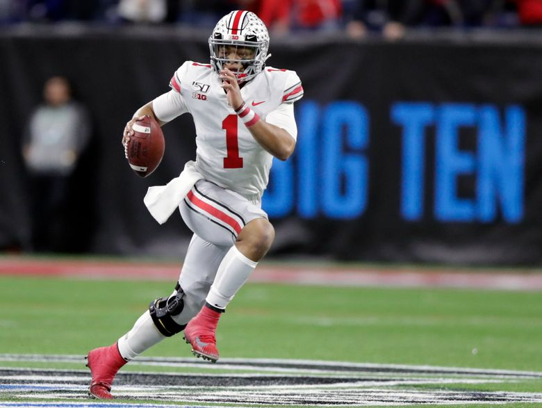 FILE – In this Dec. 7, 2019, file photo, Ohio State quarterback Justin Fields (1) runs with the ball against Wisconsin during the first half of the Big Ten championship NCAA college football game, in Indianapolis. The Big Ten won't play football this fall because of concerns about COVID-19, becoming the first of college sports' power conferences to yield to the pandemic. The move announced Tuesday, Aug. 11, 2020, comes six day after the conference that includes historic programs such as Ohio State, Michigan, Nebraska and Penn State had released a revised conference-only schedule that it hoped would help it navigate a fall season with potential COVID-19 disruptions. (AP Photo/Michael Conroy, File)