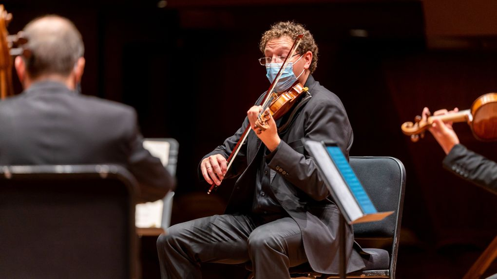 Seattle Symphony string players, including Concertmaster Noah Geller, rehearse for a season unlike any other. (James Holt / Seattle Symphony)