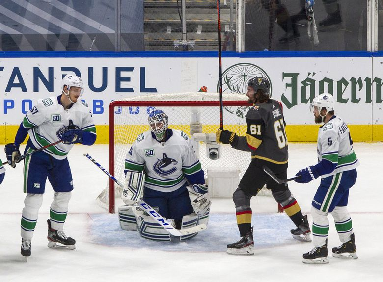 Vancouver Canucks goalie Thatcher Demko (35) reacts after giving up a gol as Vegas Golden Knights' Mark Stone (61) celebrates while Canucks' Tyler Myers (57) and Oscar Fantenberg (5) skate nearby during the second period of Game 5 of an NHL hockey second-round playoff series, Tuesday, Sept. 1, 2020, in Edmonton, Ontario.  (JASON FRANSON / The Associated Press)