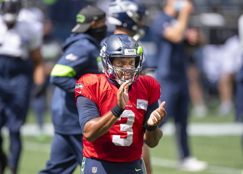 Russell Wilson helps his team psyche up for Saturday's scrimmage. The Seattle Seahawks held a scrimmage game at CenturyLink Field Saturday, August 22, 2020. 214793 214793 (Dean Rutz / The Seattle Times)