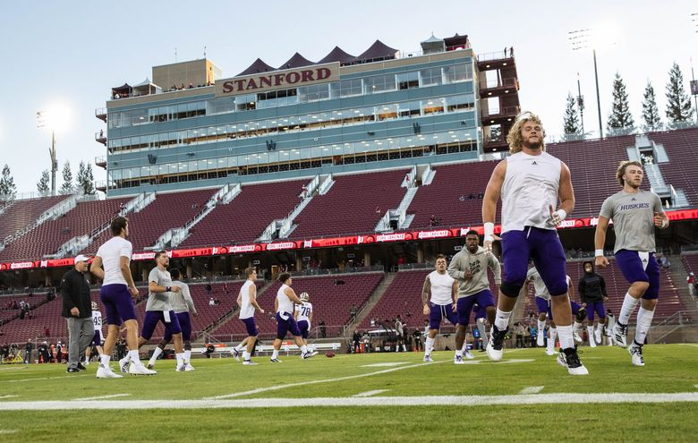Washington warms up for its game at Stanford last season.   (Dean Rutz / The Seattle Times)