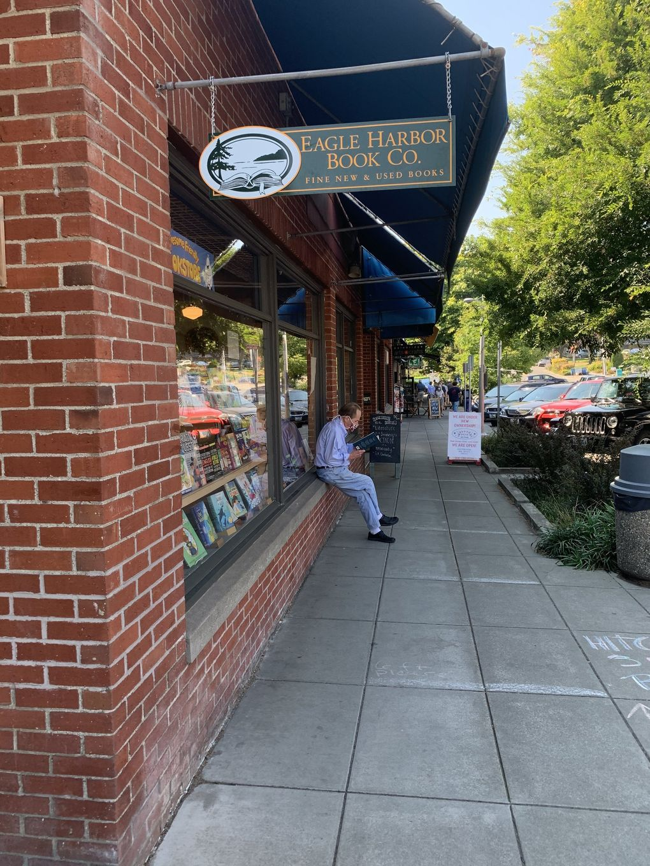 Leland Jones reads outside Eagle Harbor Book Company, a Bainbridge Island community staple for a half-century as of this month. (Courtesy of Eagle Harbor Books)