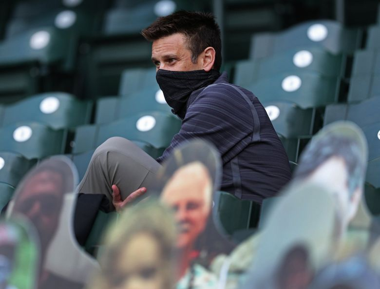 Mariners general manager Jerry Dipoto watches from the stands at T-Mobile Park last season. (Ken Lambert / The Seattle Times)