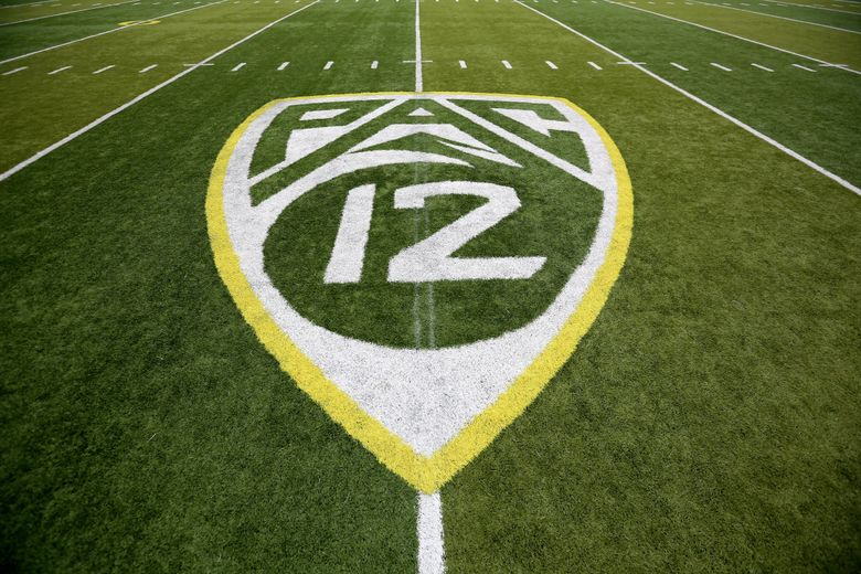A PAC-12 logo is seen painted on the field before an NCAA college football game between Washington State and Oregon in Eugene, Ore.  (Ryan Kang / AP)