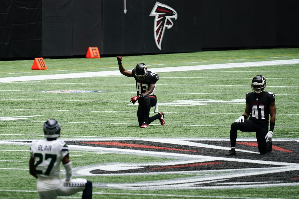 Players kneel in rememberance of Rep. John Lewis during the first half of an NFL football game between the Atlanta Falcons and the Seattle Seahawks, Sunday, Sept. 13, 2020, in Atlanta. (AP Photo/Brynn Anderson) GAMS112 GAMS112 (Brynn Anderson / The Associated Press)