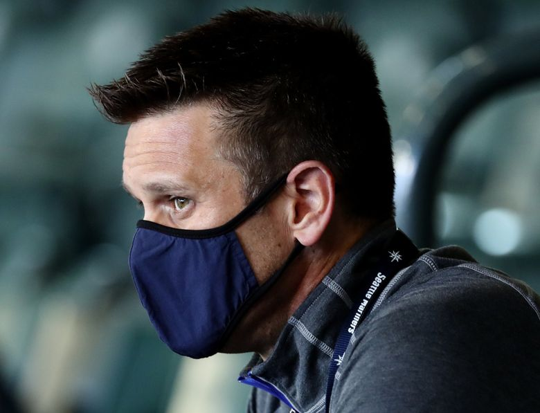 Mariners general manager Jerry Dipoto watches starting pitcher Marco Gonzales in the first inning against Texas, Monday, Sept. 7, 2020 at T-Mobile Park in Seattle. 214975 (Ken Lambert / The Seattle Times)