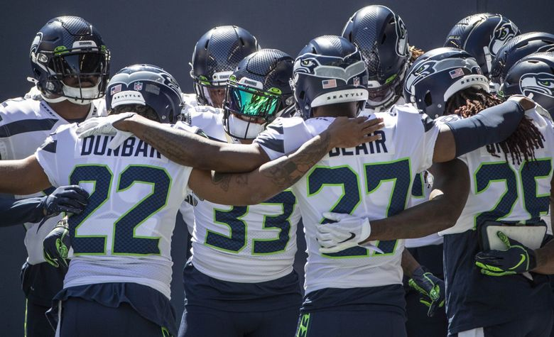 Jamal Adams takes the center of the circle as the Seahawks defense comes on to the field for the mock game Aug. 26 at CenturyLink Field. (Dean Rutz / The Seattle Times)