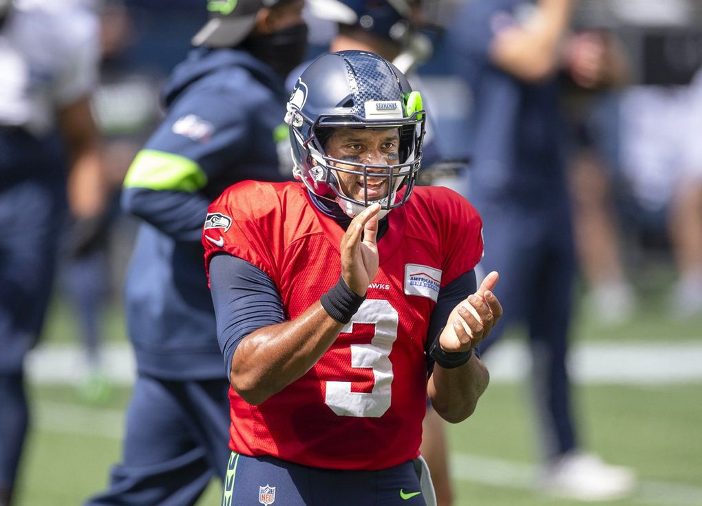 Russell Wilson helps the Seahawks psych up for their scrimmage Aug 22. (Dean Rutz / The Seattle Times)