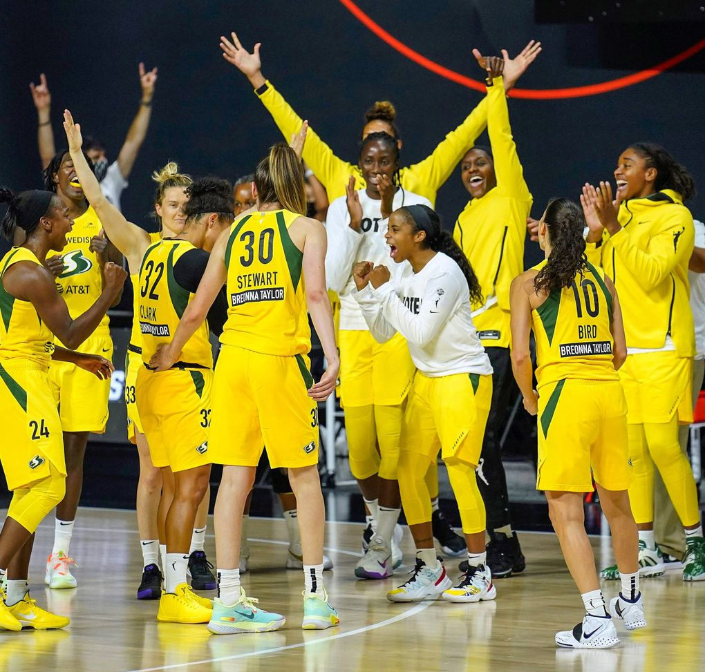 The Seattle Storm celebrate their win over Minnesota Lynx during the second half of Game 1 of a WNBA basketball semifinal round playoff series Tuesday, Sept. 22, 2020, in Bradenton, Fla. (Chris O'Meara / AP)
