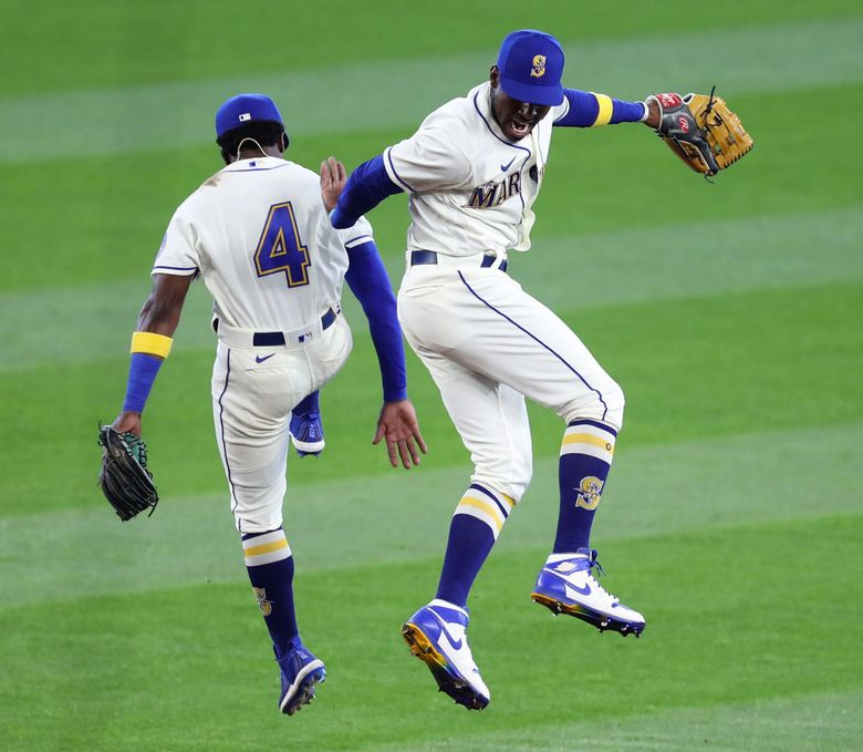 Shed Long Jr. (4) and Kyle Lewis celebrate after beating Texas on Sept. 6 at T-Mobile Park. Long and Lewis figure to be key players for the Mariners' 2021 attempt to break a postseason drought that dates back to 2001. (Ken Lambert / The Seattle Times)
