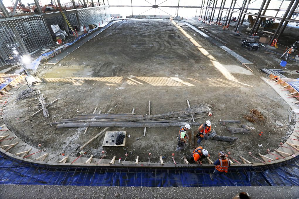 Ice rink No. 1 is seen under construction during a tour of the Northgate Mall NHL training center for the Seattle Kraken, Wednesday, Sept. 30, 2020 in Seattle. At left in the background is where the locker rooms and workout rooms will be. The photo was taken from the bar area, and a video screen will be directly across the rink on the far wall, where natural night is currently coming in. (Ken Lambert / The Seattle Times)