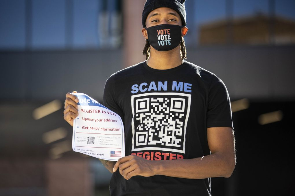 Washington's Hameir Wright joined teammates on the mens and women's basketball teams walking campus Monday looking to sign up voters.  (Dean Rutz / The Seattle Times)