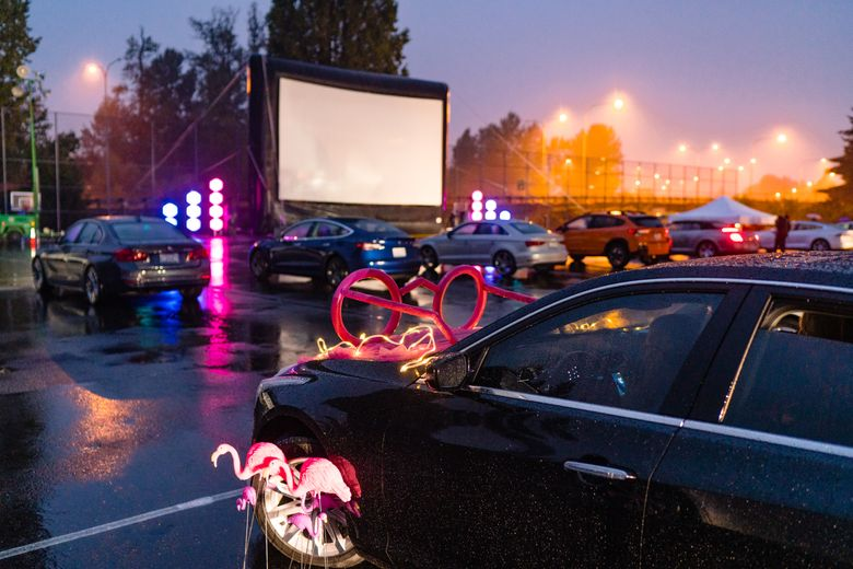 Seattle Symphony holds a screening at Marymoor Park of its 2020 opening night concert, recorded earlier that week at Benaroya Hall. (Brandon Patoc)