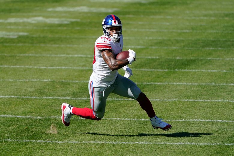 FILE – In this Sunday, Sept. 20, 2020, file photo, New York Giants tight end Evan Engram (88) runs after a catch against the Chicago Bears during the second half of an NFL football game in Chicago. The 2017 first-round draft pick had shown flashes in his first three seasons, only to be slowed by injuries, again and again. (AP Photo/Charles Rex Arbogast, File)