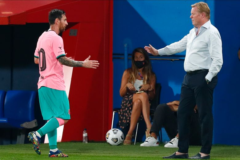 Barcelona's Lionel Messi, left, shakes hands as he is substituted with Barcelona's coach Ronald Koeman as he is substituted during the pre-season friendly soccer match between Barcelona and Girona at the Johan Cruyff Stadium in Barcelona, Spain, Wednesday, Sept. 16, 2020. (AP Photo/Joan Monfort)