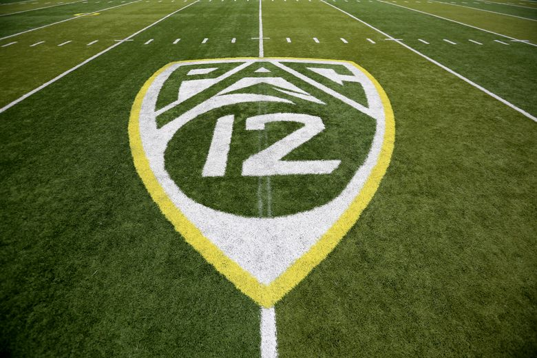 In this Oct. 10, 2015, file photo, a PAC-12 logo is displayed on the field before an NCAA college football game between Washington State and Oregon in Eugene, Ore.  (AP Photo/Ryan Kang, File)