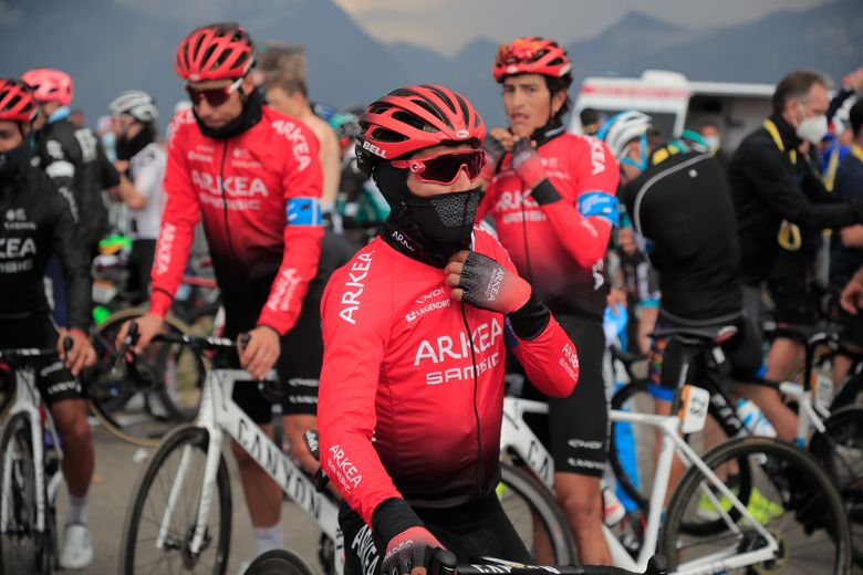 Colombia's Nairo Quintana and teammates dress up in warm clothes prior to descending from Loze pass after finishing stage 17 of the Tour de France cycling race over 107 kilometers (105.6 miles) from Grenoble to Meribel Col de la Loze, France, Wednesday, Sept. 16, 2020. (Christophe Petit-Tesson/Pool via AP)