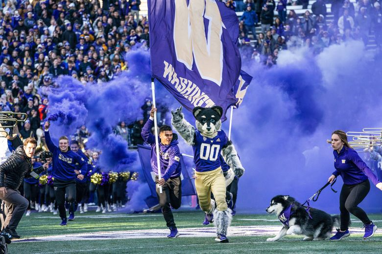 The Huskies come outof the locker room to play the Washington State Cougars in the 2019 Apple Cup in Seattle. (Dean Rutz / The Seattle Times)