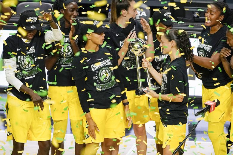 Sue Bird shows the WNBA Championship trophy to teammates after the team swept the Las Vegas Aces in three games to win the WNBA championship on Tuesday in Bradenton, Fla. (Chris O'Meara / Associated Press)