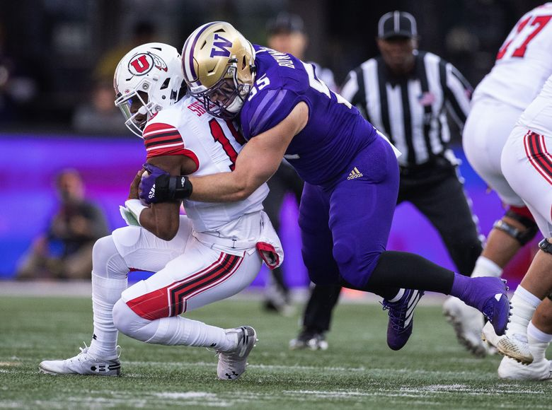 On 3rd and 4 from the 44, Washington's Ryan Bowman gets to Utah's Jason Shelley and drops him for a 6-yard loss in the 1st quarter.  The 9th-ranked Utah Utes played the Washington Huskies in Pac-12 football Saturday, November 2, 2019 at Husky Stadium in Seattle, WA. (Dean Rutz / The Seattle Times)