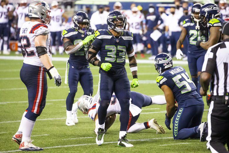 Seahawks strong safety Jamal Adams celebrates a defensive stop on Patriots running back Rex Burkhead on Sept. 20. (Bettina Hansen / The Seattle Times)