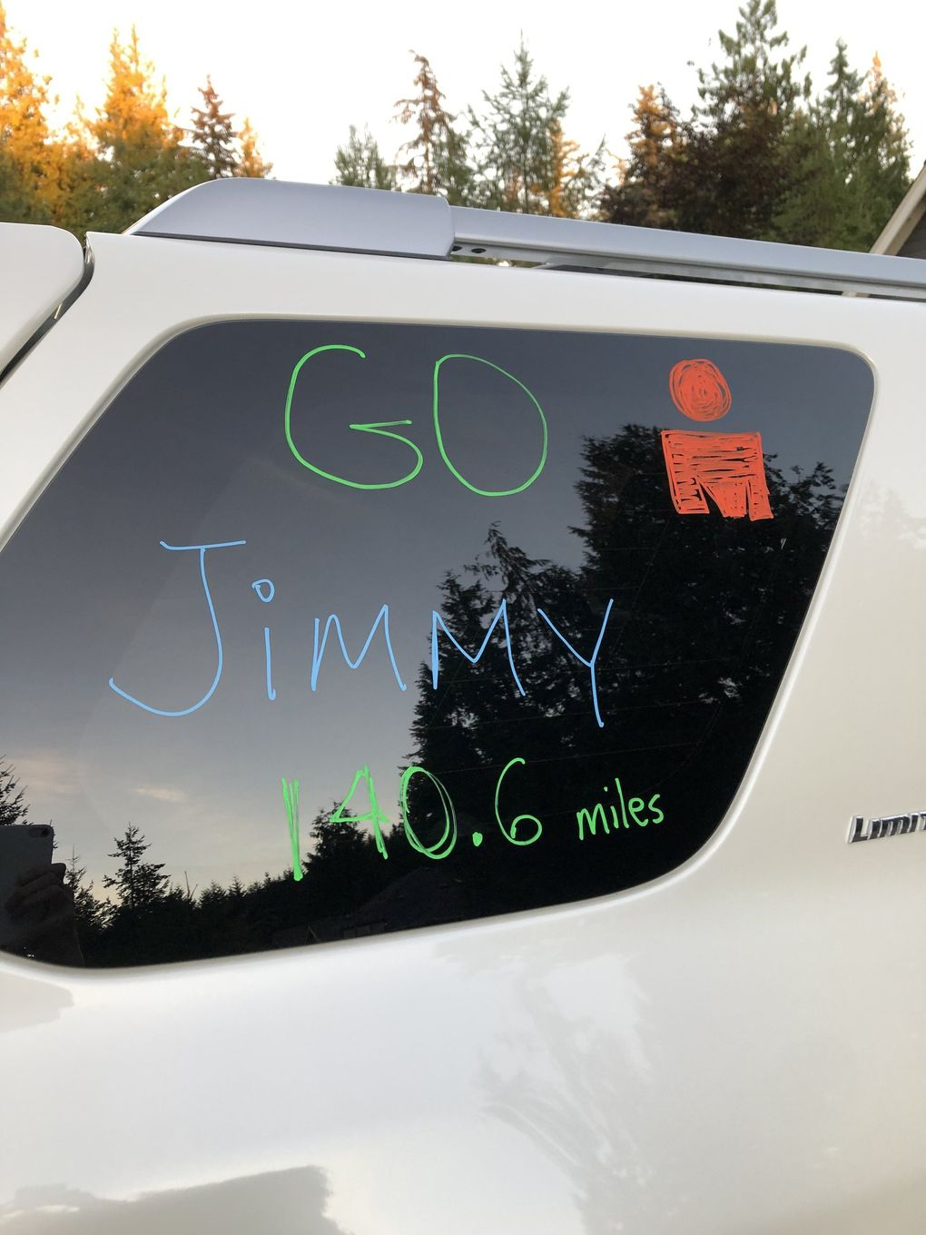 """The Watts family wrote words of encouragement for Jimmy Watts on their car prior to his embarking on the """"Solo Man"""" triathlon.  (Photo courtesy Jimmy Watts / )"""