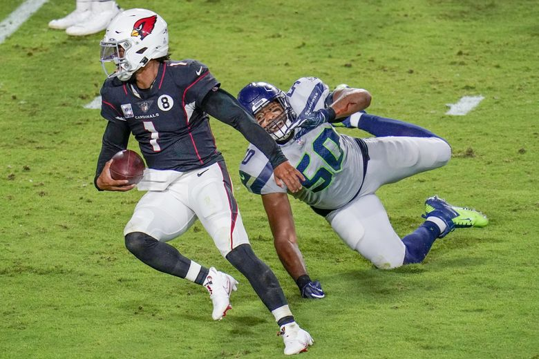 Arizona Cardinals quarterback Kyler Murray breaks the tackle of Seattle Seahawks outside linebacker K.J. Wright and rushes for a touchdown during the second half on Sunday in Glendale, Ariz. (Ross D. Franklin / AP)