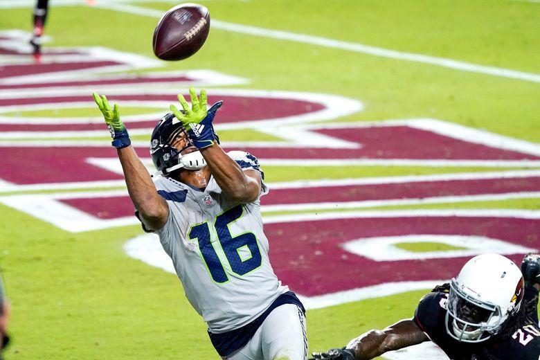 Seahawks wide receiver Tyler Lockett pulls in a touchdown pass as Arizona Cardinals cornerback Dre Kirkpatrick defends in the second half Sunday in Glendale, Arizona.  (Ross D. Franklin / The Associated Press)