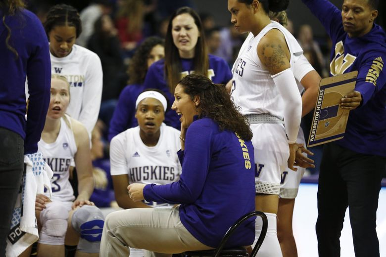 Washington Huskies head coach Jody Wynn brings the team in after a surge in points against Vanderbilt Commodores on Saturday, Dec. 21, 2019 at Alaska Airlines Arena in Seattle.  (Amanda Snyder / The Seattle Times)