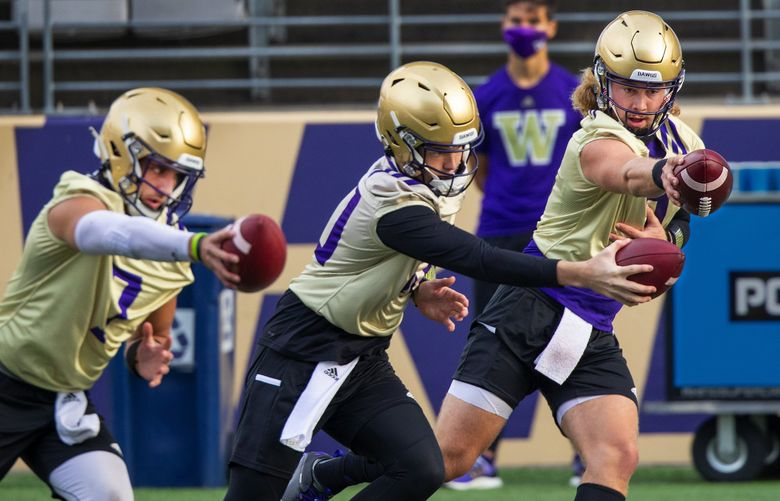 Husky quarterback's Kevin Thomson, left, Ethan Garbers, and Jacob Sirmon workout as the University of Washington Huskies practice at Husky Stadium on Friday October 9, 2020. (Mike Siegel / The Seattle Times)