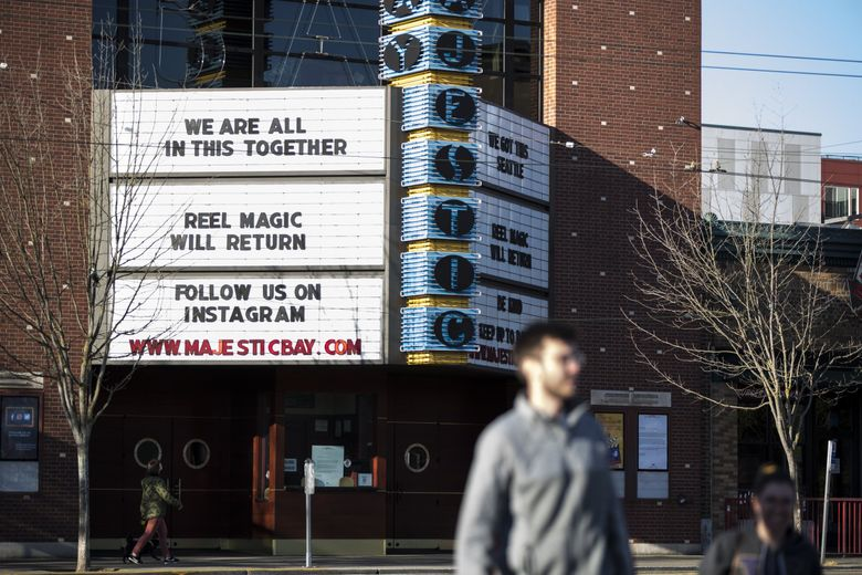 Majestic Bay Theatre closed down due to the stay-at-home order, but has an uplifting message for downtown Ballard. Theaters in Phase 2 counties are now cleared to reopen, but the question is, will they?  (Amanda Snyder / The Seattle Times)