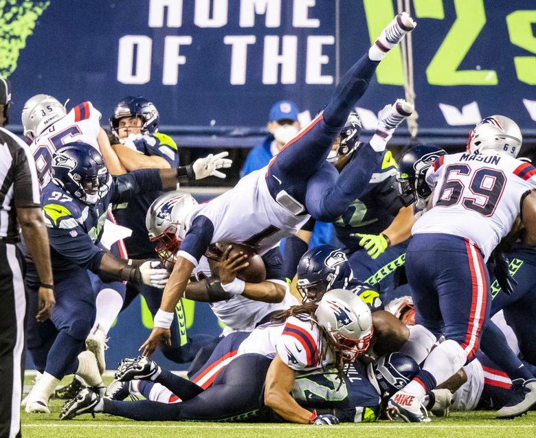 Patriots quarterback Cam Newton is stopped at the goal line on a last-second drive, securing the Seahawks' 35-30 win over the New England Patriots for their home opener at CenturyLink Field on Sept. 20.  (Bettina Hansen / The Seattle Times)