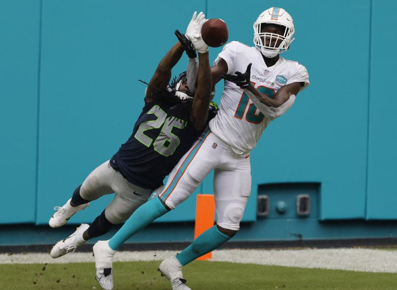 MIAMI GARDENS, FLORIDA – OCTOBER 04: Shaquill Griffin #26 of the Seattle Seahawks breaks up a pass intended for Preston Williams #18 of the Miami Dolphins during the fourth quarter at Hard Rock Stadium on October 04, 2020 in Miami Gardens, Florida. (Photo by Michael Reaves/Getty Images) 775563462 (Michael Reaves / Getty Images)