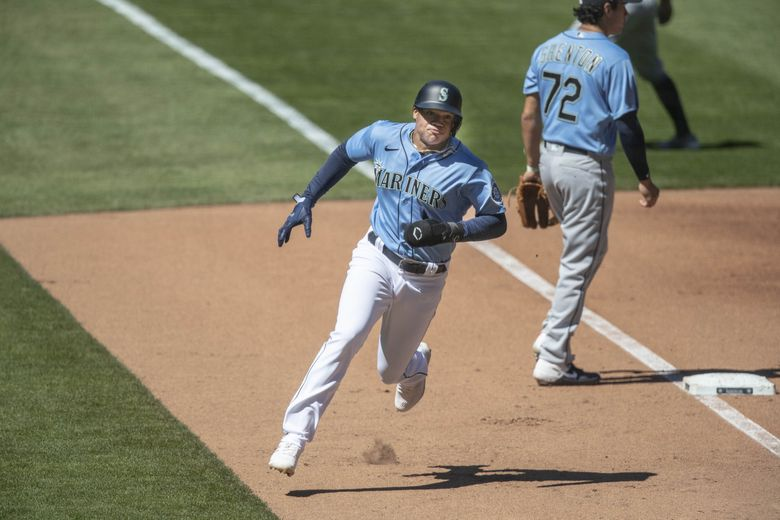 Julio Rodriguez scores on the two-run Sam Haggerty double in the 2nd.  The Seattle Mariners held Summer Camp at T-Mobile Park Wednesday, July 15, 2020. (Dean Rutz / The Seattle Times)