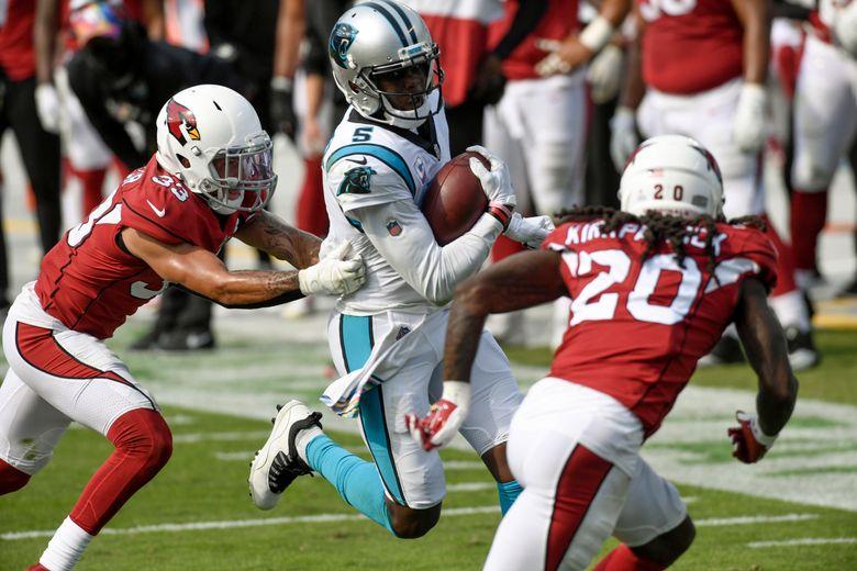 Carolina Panthers quarterback Teddy Bridgewater runs between Arizona Cardinals cornerback Byron Murphy, left, and cornerback Dre Kirkpatrick during the second half of an NFL football game Sunday, Oct. 4, 2020, in Charlotte, N.C. (AP Photo/Mike McCarn)