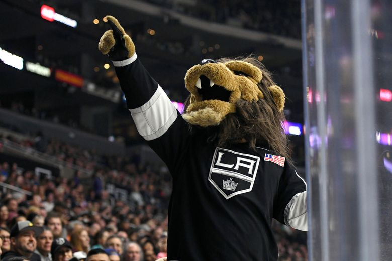 FILE – In this Sept. 30, 2017, file photo, Los Angeles Kings mascot Bailey entertains the crowd during a preseason NHL hockey game against the Anaheim Ducks in Los Angeles. The Los Angeles Kings have fired the employee who dresses as the hockey team's mascot after an investigation into a sexual harassment lawsuit filed against him earlier this year.  (AP Photo/Michael Owen Baker, File)