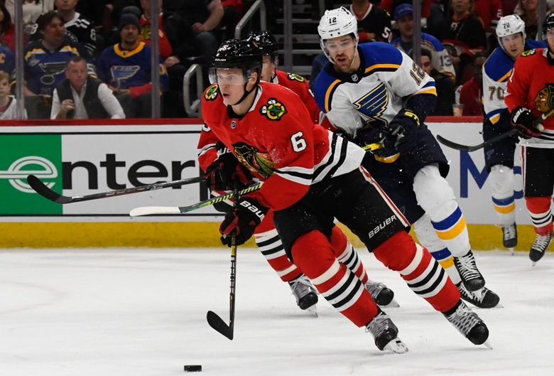FILE – In this March 8, 2020, file photo, Chicago Blackhawks defenseman Olli Maatta (6) moves the puck away from St. Louis Blues left wing Zach Sanford (12) during the first period of an NHL hockey game in Chicago. The Los Angeles Kings have acquired Maatta from the Blackhawks in a trade for minor league forward Brad Morrison. The Kings announced the deal Sunday, Oct. 4, 2020, to acquire Maatta, a two-time Stanley Cup champion with Pittsburgh. (AP Photo/Matt Marton, File)