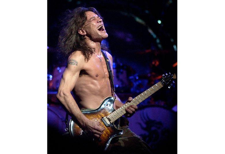 Van Halen guitarist Eddie Van Halen performs in 2004 in Phoenix. Van Halen, who had battled cancer, died Tuesday. He was 65. (AP Photo/Tom Hood, file)