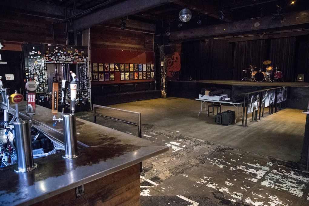 """The main room at the Crocodile has seen many shows. """"On the flip side, though, this building in and of itself doesn't encapsulate the Crocodile,"""" says co-owner Marcus Charles. """"The people … the history, the bands who come through — all those things are what really made the Crocodile."""" (Amanda Snyder / The Seattle Times)"""