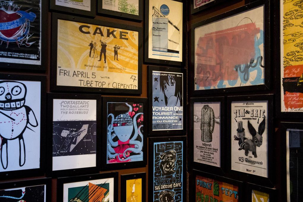 Posters from old shows line the walls of the Crocodile in Belltown. The Croc has been an important milestone club for Seattle greats from different genres and generations. (Amanda Snyder / The Seattle Times)