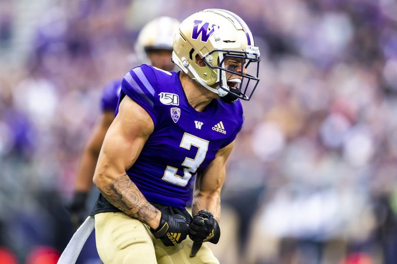 Washington defensive back Elijah Molden celebrates a tackle in the first half as the University of Washington Huskies take on the Hawaii Rainbow Warriors at Husky Stadium in Seattle Saturday September 14, 2019.  (Andy Bao / The Seattle Times)
