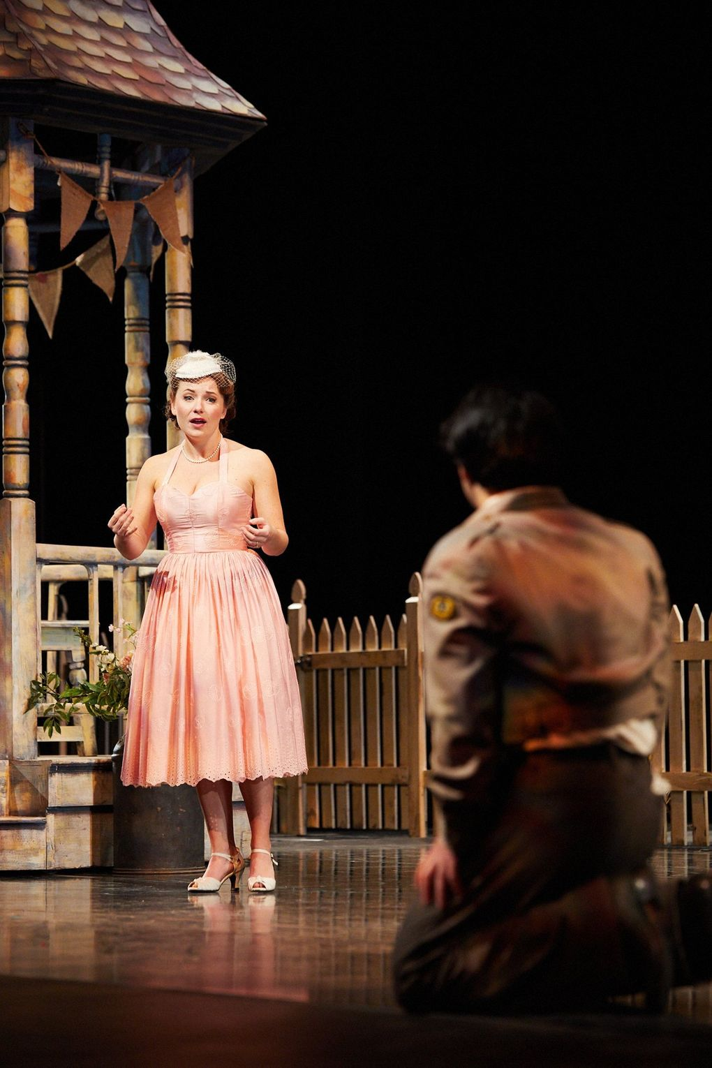 """Madison Leonard (who portrays Adina) and Andrew Stenson (Nemorino) perform with socially distanced staging for Seattle Opera's """"The Elixir of Love."""" (Philip Newton)"""