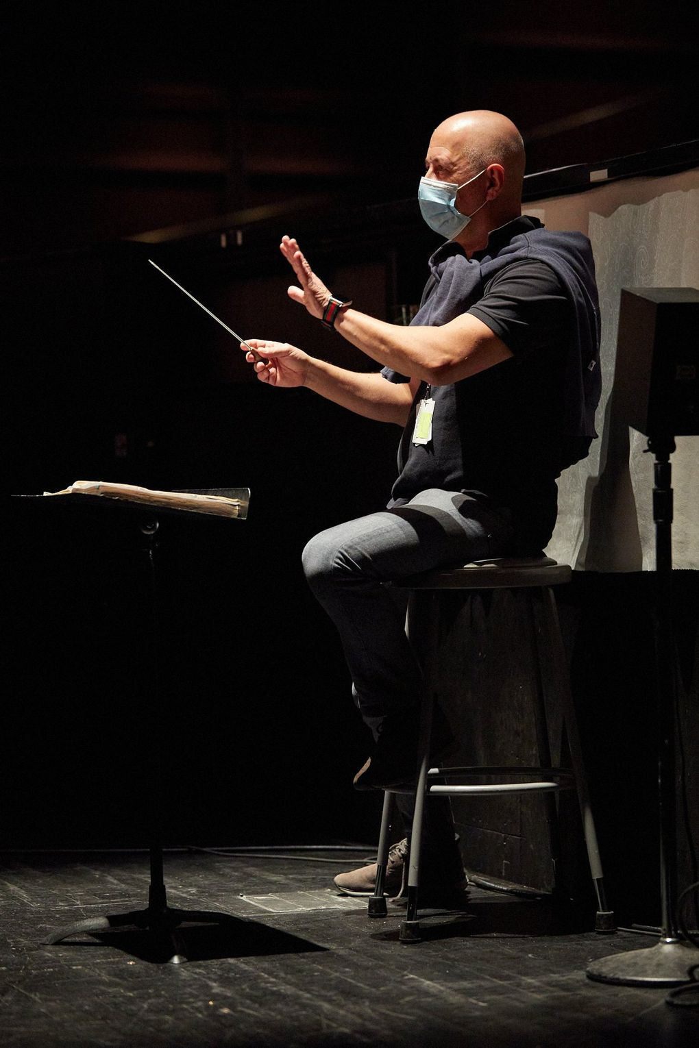 """Maestro Carlo Montanaro in the orchestra pit for the filming of Seattle Opera's """"The Elixir of Love."""" (Philip Newton)"""