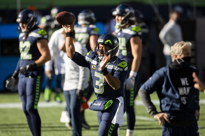 Seahawks quarterback Russell Wilson warms up before the Seattle Seahawks take on the San Francisco 49ers at CenturyLink Field in Seattle Sunday November 1, 2020.  (Bettina Hansen / The Seattle Times)