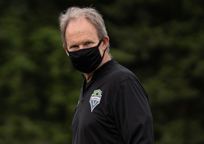 Sounders head coach Brian Schmetzer wears a mask as the team returns to practice Monday, May 18, 2020 at Starfire Sports in Tukwila.  (Paul-Michael Ochoa / Sounders FC)