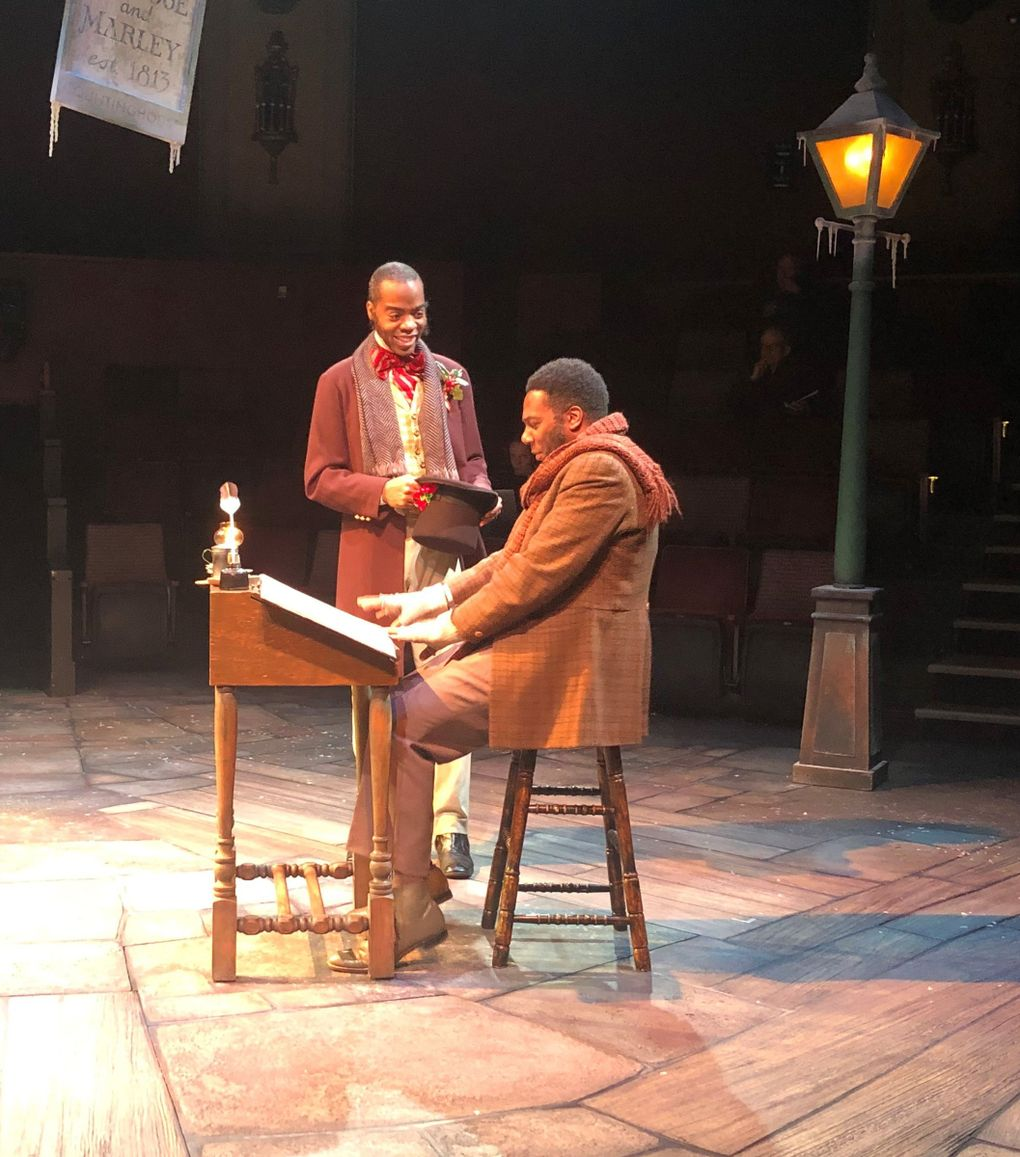 """Arlando Smith as Fred and Reginald A. Jackson as Bob Cratchit in ACT's 2018 production of """"A Christmas Carol."""" (Amy Gentry)"""