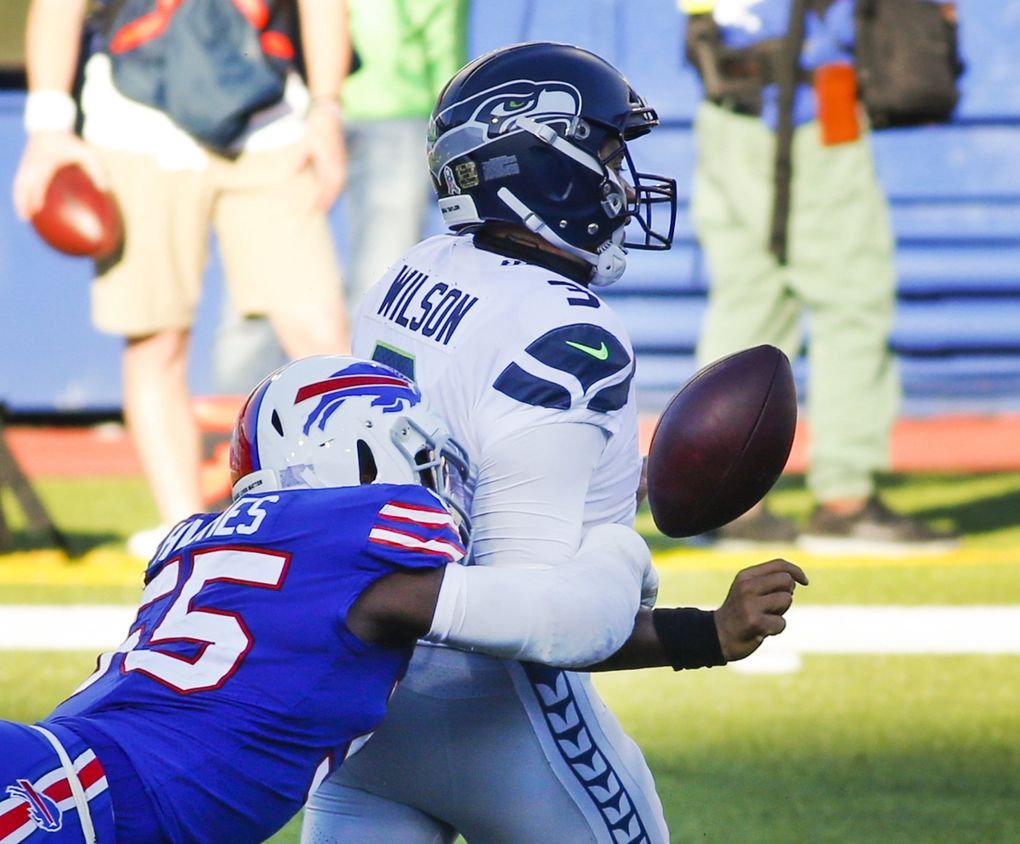 The Bills' Jerry Hughes (55) knocks the ball away from Seahawks quarterback Russell Wilson to force a fumble in the second half Sunday in Orchard Park, New York. (Jeffrey T. Barnes / The Associated Press)