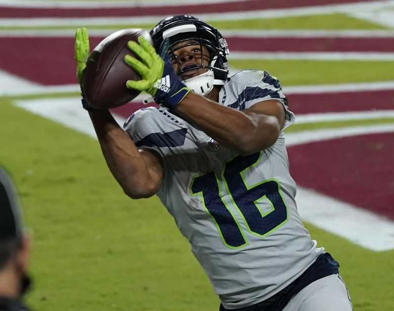 Seahawks wide receiver Tyler Lockett pulls in a touchdown pass against the Arizona Cardinals on Oct. 25 in Glendale, Arizona. Will Lockett have another strong game Sunday against the Bills, or will fellow receiver DK Metcalf steal the show again? (Ross D. Franklin / AP)