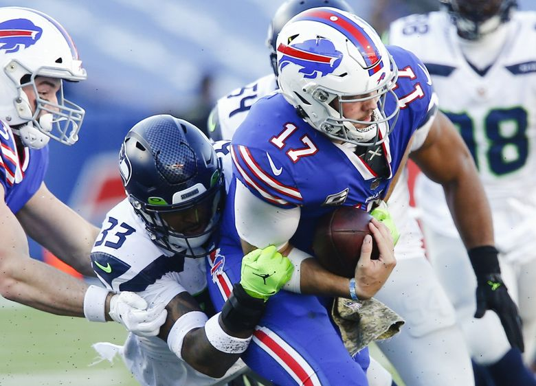 Seahawks strong safety Jamal Adams (33) sacks Buffalo Bills quarterback Josh Allen in the second half Sunday in Orchard Park, New York. (John Munson / The Associated Press)